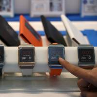 Smart-watches were one of 2013's big tech disappointments, but it's too early to write the year off yet. | BLOOMBERG