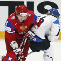 From Russia with love: Russian fans expect Alex Ovechkin and company to deliver a gold medal at the Sochi Olympics. | AP