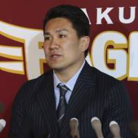 Major money: Masahiro Tanaka speaks at a news conference in Sendai on Thursday after agreeing to a seven-year, $155 million deal with the New York Yankees. | KYODO