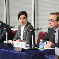 German view: Reymer Kluver (right) answers an audience question as Sascha Quaiser (left) and Dana Heide look on at a Keizai Koho Center symposium in Tokyo on Dec. 2.   SATOKO KAWASAKI