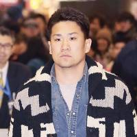 Man in demand: Pitcher Masahiro Tanaka walks through Narita Airport on Saturday following his return from a trip to the United States to meet with several teams interested in his services. | KYODO
