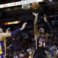Soft touch: Miami's Ray Allen puts up a shot against Los Angeles' Pau Gasol in the first quarter on Thursday night. The Heat defeated the Lakers 109-102. | AP