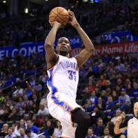 Filling it up: Oklahoma City's Kevin Durant puts up a jumper against Atlanta in the fourth quarter on Monday night. | AP
