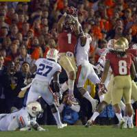 Decisive play: Florida State's Kelvin Benjamin catches the game-winning TD in the BCS national championship game against Auburn on Monday night at the Rose Bowl. The Seminoles beat the Tigers 34-31. | AP