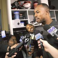 Putting it in perspective: San Francisco tight end Vernon Davis speaks to reporters at the team's training facility in Santa Clara, California, on Monday. The 49ers lost to the Seattle Seahawks 23-17 in the NFC Championship Game on Sunday. | AP