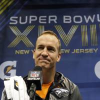 Reserved: Denver Broncos QB Peyton Manning appears during Super Bowl XLVIII Media Day on Tuesday in Newark, New Jersey. | AP