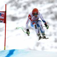 Soaring: Switzerland's Patrick Kueng goes airborne on the way to victory in a World Cup downhill in Wengen, Switzerland, on Saturday. Kueng won in a time of 1 minute, 32.66 seconds. | AP