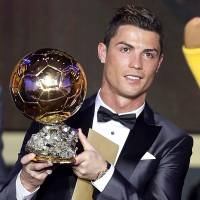 Pinnacle prize: Real Madrid star Cristiano Ronaldo holds the Ballon d'Or aloft after being named the FIFA world player of the year on Monday night in Zurich.   AP