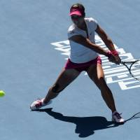 Pushed: Li Na plays a shot from the Czech Republic's Lucie Safarova in their third-round match at the Australian Open on Friday. | AFP-JIJI