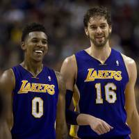Just the two of us: Lakers players Nick Young (left) and Pau Gasol share a moment during Los Angeles' 112-106 victory over the Raptors on Sunday in Toronto. | AP