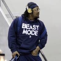 Altered Beast: Seattle running back Marshawn Lynch walks off the plane after arriving in Jersey City, New Jersey. | AP