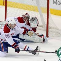Double obstacle: Dallas' Cody Eakin takes a shot as Montreal's Josh Gorges (center) and Carey Price defend on Thursday. | AP