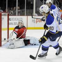 Side angle: St. Louis' Alexander Steen scores past New Jersey's Cory Schneider in the first period on Tuesday night. | AP