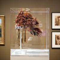 Trail blazers: Artifacts on display in the exhibition 'Go West! Art of the American Frontier from the Buffalo Bill Center of the West' at the High Museum of Art in Atlanta include a native American feather bonnet from 1890. | AP
