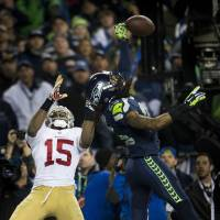 That's all she wrote: Seahawks cornerback Richard Sherman deflects a pass in the end zone intended for Michael Crabtree on the 49ers' final play of Seattle's 23-17 win. | AP