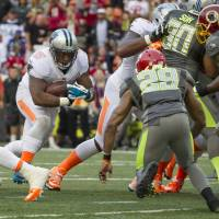 Cat scratch fever: Panthers running back Mike Tolbert runs in a 2-point conversion to give Team Rice a 22-21 lead in the fourth quarter of the Pro Bowl on Sunday in Honolulu. | AP