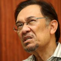 Suddenly unwelcome: Malaysian opposition leader Anwar Ibrahim is interviewed in June 2013. | AFP-JIJI