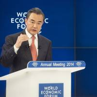 On the offensive: Chinese Foreign Minister Wang Yi addresses a session of the World Economic Forum in Davos, Switzerland, on Friday. | AP