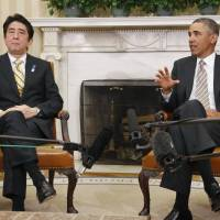 One on one: Prime Minister Shinzo Abe and U.S. President Barack Obama speak in front of the cameras during their summit last February in Washington. | KYODO