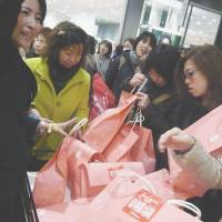 'Fukubukuro' frenzy: Women rush to buy fukubukuro (lucky bags) filled with discounted mystery merchandise Thursday as Kintetsu Department Store's flagship outlet in Osaka kicked off its first day of business for the new year. The economy may hit a soft spot after the sales tax climbs to 8 percent in April, analysts warn. | KYODO