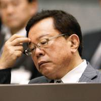 Explaining his actions: Tokyo Gov. Inose Naoki gestures as he fields a question from a member of the Tokyo Metropolitan Assembly on Dec. 17. | KYODO