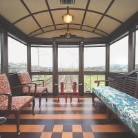 Varnish: The rear lounge car of JR Kyushu's planned Sweets Train offers comfort and a view.   KYODO