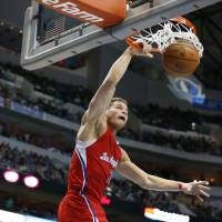 Send it in: Clippers forward Blake Griffin dunks during Los Angeles' 119-112 win over the Mavericks on Friday in Dallas. | AP