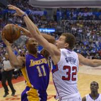 Not in my house: Clippers forward Blake Griffin (32) tries to block a shot by the Lakers' Wesley Johnson during their game on Friday in Los Angeles. The Clippers won 123-87.   AP