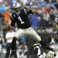 Anything you can do: Mobile quarterbacks like Cam Newton (above) force opposing defenses to be wary of their ability to run as well as throw the football. | AP