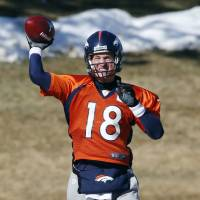 Familiar sight: Broncos quarterback Peyton Manning has been cast as the hero during the buildup to Super Bowl XLVIII. | AP