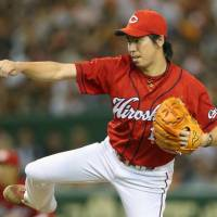 On the hook: Carp ace Kenta Maeda is on the MLB radar. | KYODO