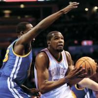 All-time high: Oklahoma City's Kevin Durant drives to the basket during the Thunder's win over the Warriors. | AP