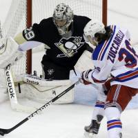 Wanna try that again?: The Rangers' Mats Zuccarello loses control of the puck as Penguins goalie Marc-Andre Fleury guards the net on Friday. | AP
