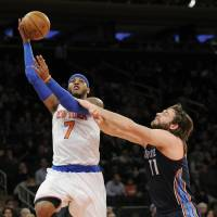 All day long: Knicks forward Carmelo Anthony goes up for a shot against the Bobcats' Josh McRoberts on Friday.   AP