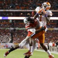 I'll take that: Clemson's Martavis Bryant outduels Ohio State's Armani Reeves in the end zone. | AP