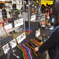 Balancing act: Parts for pedal-free bicycles are put out for sale during a promotional event in Tokyo in November.   KYODO