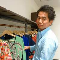 Connections: Enigmo director Hideo Ando sorts through some of the brand-name clothes to be sold on Buyma, the firm's 'social fashion site.'   KYODO