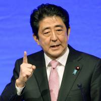 Reinterpreter: Prime Minister Shinzo Abe speaks during the Liberal Democratic Party's convention in Tokyo on Sunday. | POOL