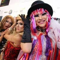 Special event: Attendees pose for photographers at the Tokyo SuperStar Awards 2013, a gala event held to recognize contributions to the lesbian, gay, bisexual and transgender community, in Tokyo on Dec. 7.  | BLOOMBERG