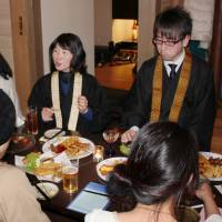 Looking for love: A Buddhist priest converses over food and drinks during a matchmaking party at a restaurant in Nagaoka, Niigata Prefecture, on Dec. 15. | KYODO