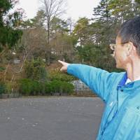 Still waiting: Yagiyama Zoological Park zookeeper Toshikazu Abe in December points to the planned construction site of a panda house inside the Sendai zoo's grounds. | KYODO