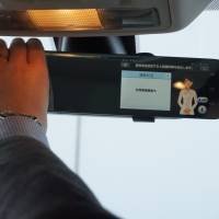 Another view: A rearview mirror equipped with a touch panel device offers the driver access to a voice-activated concierge service. | KAZUAKI NAGATA