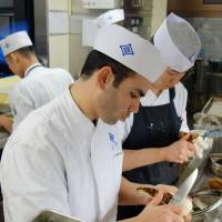 Culinary journey: Lebanese chef Imad Saade helps prepare dishes at the noted Japanese-style Kikunoi restaurant in Kyoto on Dec. 3. | KYODO