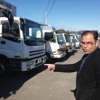 Winning bid: Naheed Akhtar checks out vehicles at a used-car auction site in Oyama, Tochigi Prefecture, in November. | WEDGE