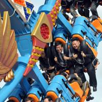 Wild ride: North Korean leader Kim Jong Un (top right) rides a roller coaster at the Rungna People's Pleasure Ground in Pyongyang in 2012. | AFP-JIJI