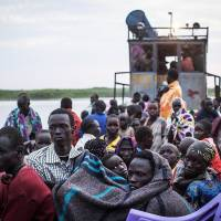 Across the Nile: South Sudanese fleeing violence in the Bor region arrive in the village of Minkammen on Thursday. | AFP-JIJI