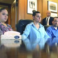 Off to court: Amber McGuire (left) and her brother and his wife, Dennis and Missie McGuire, announce in Dayton on Friday their planned lawsuit against Ohio over the unusually slow execution of the siblings' father, Dennis McGuire, the day before. | AP