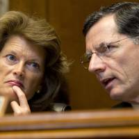 'We are behind': Alaska Sen. Lisa Murkowski, the ranking Republican on the Senate Energy and Natural Resources Committee, talks with committee member Sen. John Barrasso of Wyoming in Washington on June 6. | AP