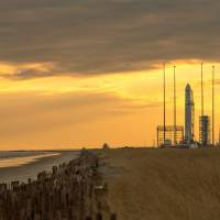 Space truck: An Orbital Sciences Corp. Antares rocket sits on a launch pad at NASA's Wallops Flight Facility in Virginia on Monday ahead of its eventual launch Thursday. The rocket is carrying out the company's first official resupply mission to the International Space Station. | AP