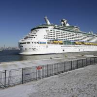 Sick at sea: The Explorer of the Seas arrives  Wednesday in Bayonne, New Jersey, after nearly 700 passengers and crew members were stricken by a suspected norovirus outbreak. | AP